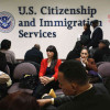 Immigrants waiting for Green Card interviews. Photo from npr.org