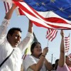 immigrants celebrating with US flag
