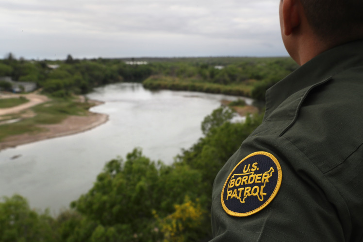 ROMA, TX - MARCH 13:  A U.S. Border Patrol agent scans the U.S.-Mexico border while on a bluff overlooking the Rio Grande on March 13, 2017 in Roma, Texas. The Border Patrol has reported that illegal crossings from Mexico have dropped some 40 percent along the southwest border since Donald Trump took office.  (Photo by John Moore/Getty Images)